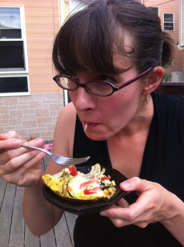 Kirsten eating Zucchini Tomato bake